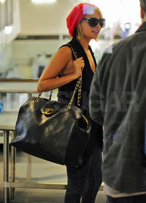 Richies Chanel Bag pictures of richie departing out of lax with a