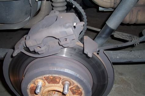 change rear brakes  rotors  dgc dodgeforumcom