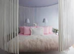 Cool Girls Rooms flocked velvet wallpaper a faux fur rug hanging curtains to divide the