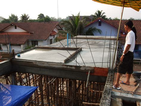 house builder house builder pouring second floor concrete slab