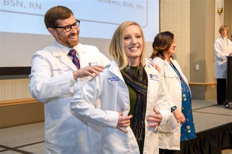 nursing school tulsa students receive white coats as they transition to