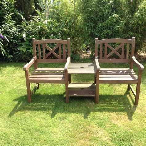 garden bench with table in middle this outdoor area only thing that could better