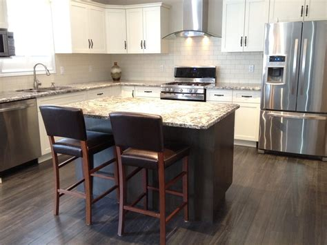 white kitchen dark island subway tile backsplash white cabinets dark island