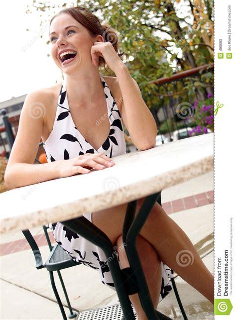 lady sitting   table  stock image image  lips