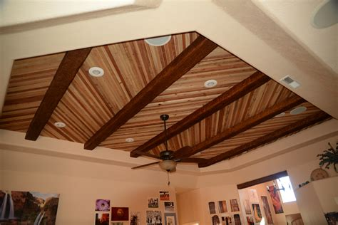 Accenting A Plank Ceiling With Beams Faux Wood Workshop Faux Wood Ceiling