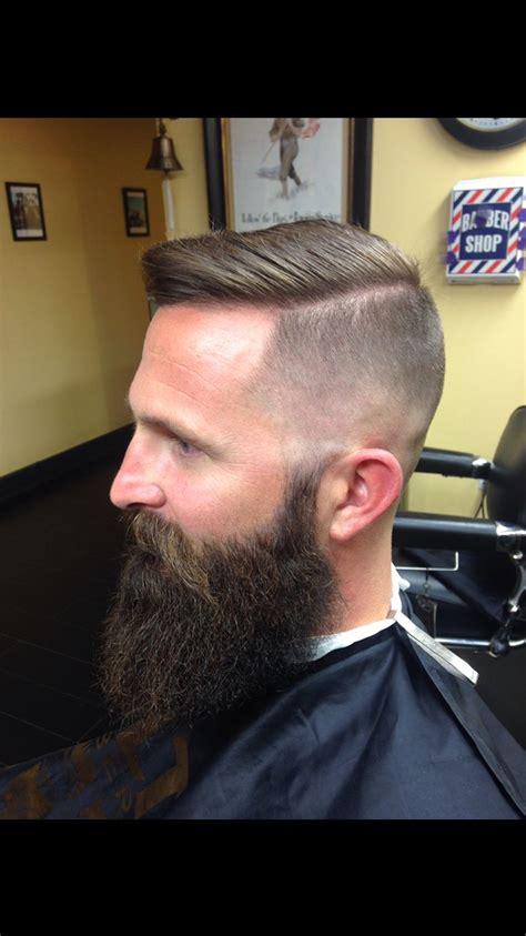 high skin fade with beard men s hair blurry high skin fade natural part
