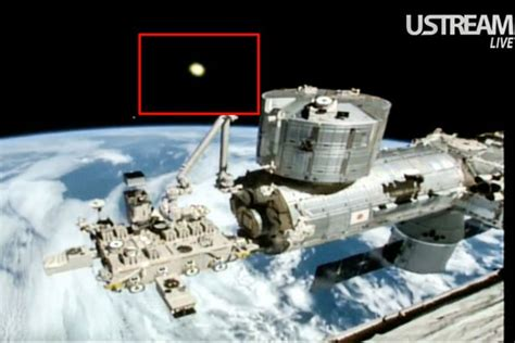 space station live mysterious beam of light emerging from the earth captured