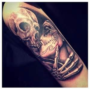sugar skull show me a man with a tattoo and i ll show