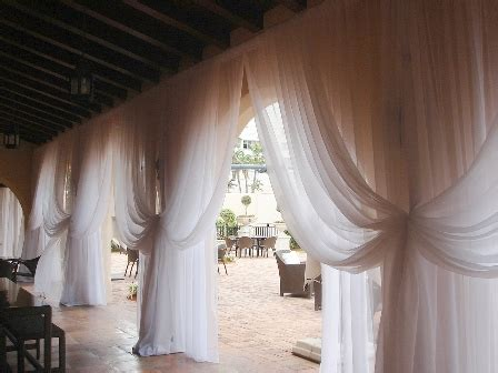 white draping pipe and drape our string trio has played in this setting