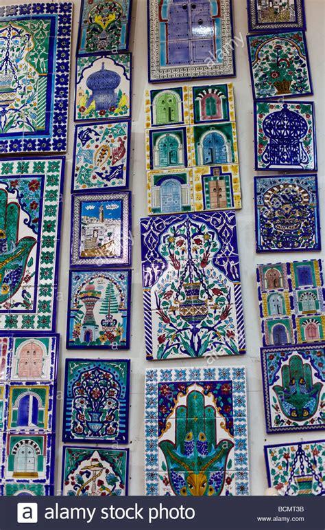 Souvenir Tas Tile Tumblergoodiebag Tile Tumbler shops in the tunis medina city display painted ceramic tiles stock photo royalty free