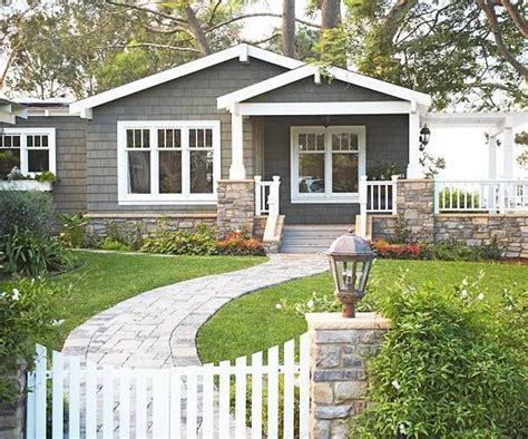 ranch style trim dark house with white windows and trim craftsman style