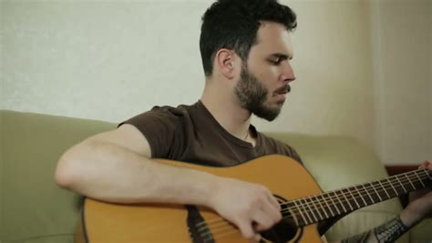 who is the guy that plays guitar and sings on the new direct tv commercials teacher talking to student in classroom stock footage