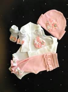 Newborn baby girl take home outfit complete with pink heart