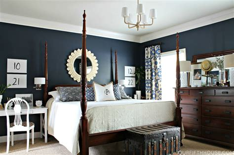 this master bedroom the wood navy blue walls