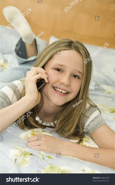 woman talking on cell phone in bed stock image f006 6900 caucasian preteen girl laying bed talking stock photo