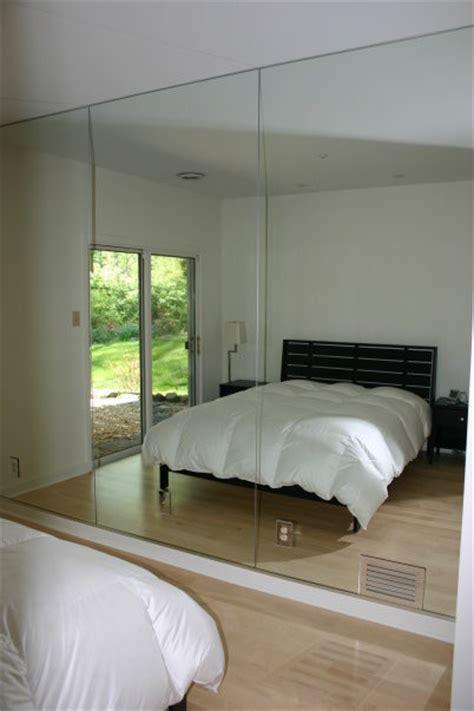 bedroom with mirror wall mirrored walls modern bedroom philadelphia by bryn