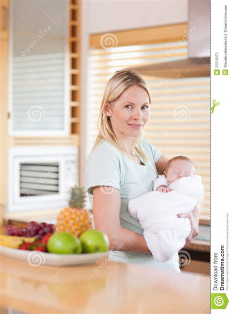Standing In The Kitchen by Side View Of Standing In The Kitchen With Baby