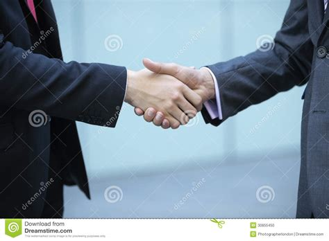 people section mid section of business people shaking hands stock photo