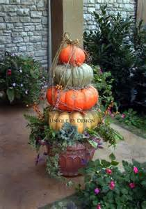 fall decorating pumpkin topiary using yellow blue and