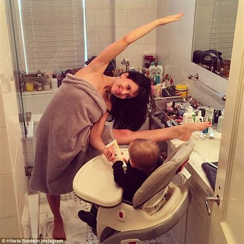 mom and me in bathroom hilaria baldwin strikes a yoga pose in her bath towel