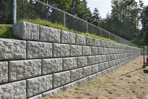 To Install The Retaining Wall Blocks The Home Redesign Garden Wall Blocks