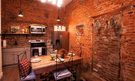 Kitchen And Dining Room by Savannah Loft Style Suite Soho Lofts