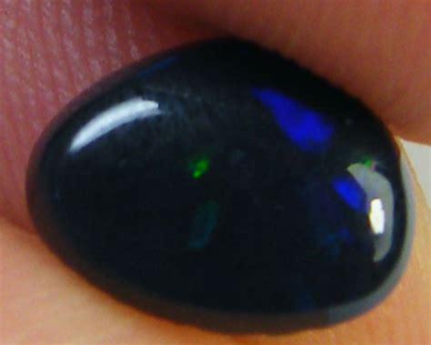 black opal mens ring n1 jet black opal mens ring 1 05 carats qo2541