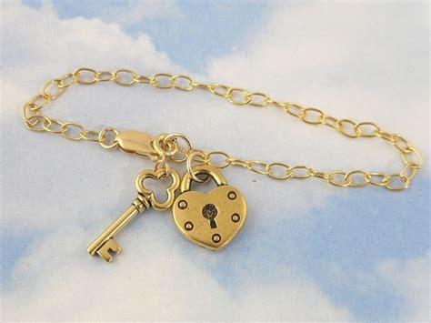 gold key to my charm bracelet lock