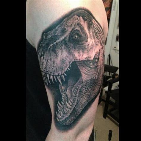 shoulder realistic dinosaur tattoo by bob tyrrel