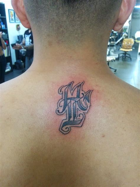 mean street tattoo gemini and scorpio sign done by the talented chris yelp
