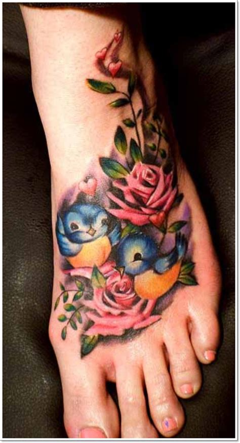 blue rose tattoo on foot 55 bright tattoos more than just a of a bird