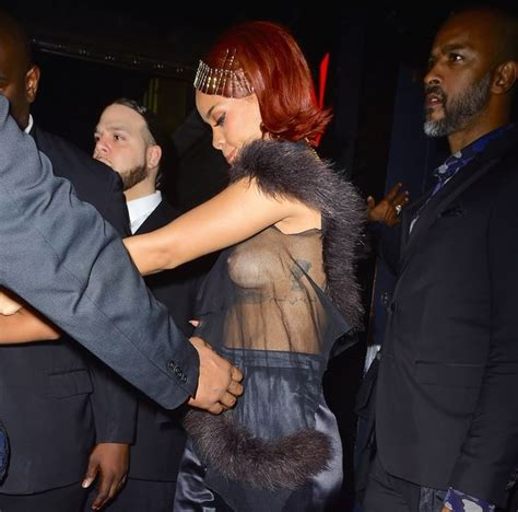 Jennifer Lawrence Caught Braless Flashes Nipple Poke Braless Rihanna Flashes Nipples In Sheer Top As She Hosts