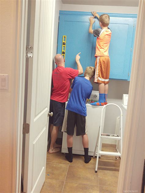 hanging cabinets in laundry room how to upgrade your laundry room with custom cabinets