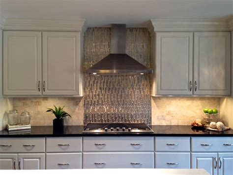 white kitchen with stainless steel backsplash black and white kitchen viking appliances gold glass and