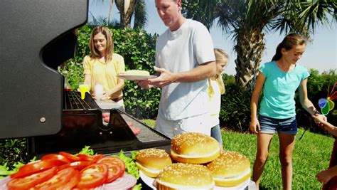 Backyard Grill Nutrition Caucasian Family Parents Children Healthy Outdoor Cooking