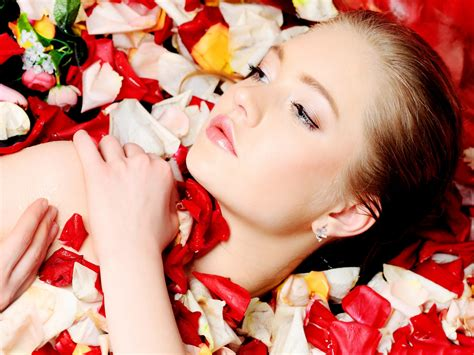 flowermodels com woman and flowers model with flower petals taking petal