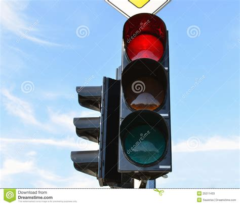 blue lights on traffic lights red color traffic light blue sky in background stock image