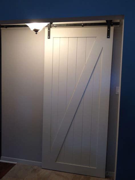 Aluminum Barn Doors The Classic White Z Panel Door With The The Heavy Metal Barn Door Hardware 1925workbench