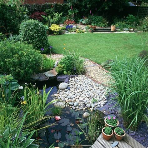 wildlife pond surrounded by pebbles housetohome co uk