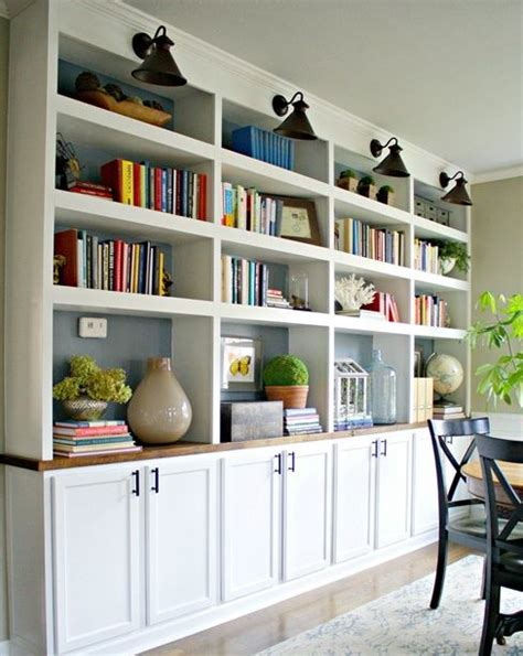 i like the look of these built in shelves with cabinets