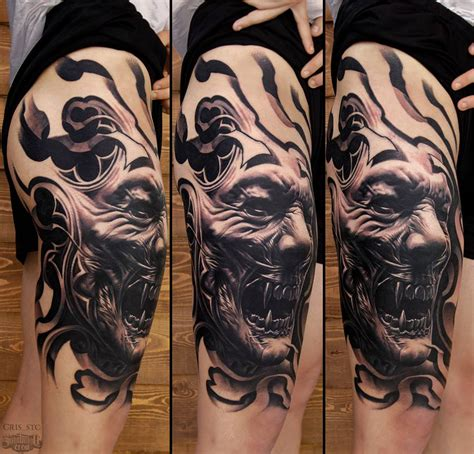 realistic black and grey thigh tattoo from cris sake
