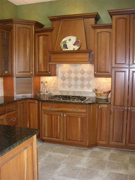 cherry cabinets with granite countertops yorktowne cherry butternut cabinets uba tuba granite