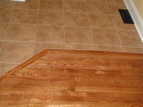 kitchen with tile and hardwood floors install hardwood