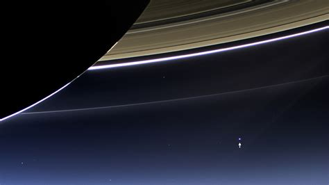 earth as seen from saturn earth and moon photographed from 900 million away