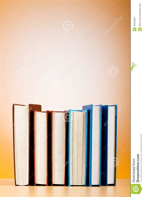 gradient books stack of text books against gradient royalty free stock