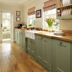 Painted kitchen step inside this traditional soft green kitchen