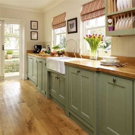 painted kitchen furniture step inside this traditional muted green kitchen