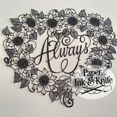 paper cut templates cut by the artist papercut paper ink and knife