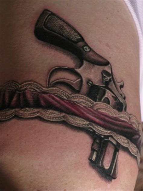 tattoo in gun realistic gun thigh garter tattoo by dark images tattoo