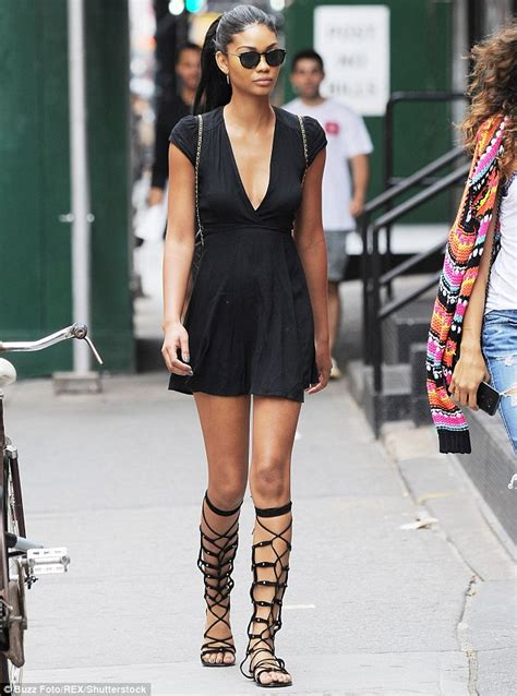 chanel iman tall chanel iman turns heads in a black dress and knee high
